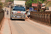 Mar. 12, 2009 -- VIENTIANE, LAOS: A cargo hauling truck crosses the single lane bridge on the Nam Lik River near Vientiane, Laos. Photo by Jack Kurtz
