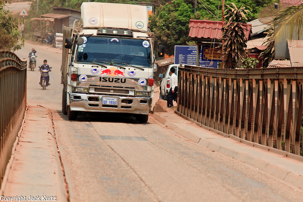 Mar. 12, 2009 -- VIENTIANE, LAOS: A cargo hauling truck crosses the single lane bridge on the Nam Lik River near Vientiane, Laos. Photo by Jack Kurtz