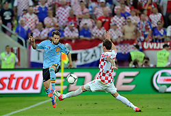 (L) Spain's Jordi Alba (nr18) fights for the ball with (R) Croatia's Mario Mandzukic (nr17) during the UEFA EURO 2012 Group C football match between Spain and Croatia at Gdansk Arena in Gdansk on June 18, 2012...Poland, Gdansk, June 18, 2012..Picture also available in RAW (NEF) or TIFF format on special request...For editorial use only. Any commercial or promotional use requires permission...Photo by © Adam Nurkiewicz / Mediasport