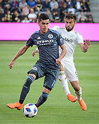 New York City forward Jesus Medina (19) moves the ball against Los Angeles FC forward Diego Rossi (9) during a MLS soccer match in Los Angeles, Sunday, May 13, 2018. (Ed Ruvalcaba/Image of Sport)