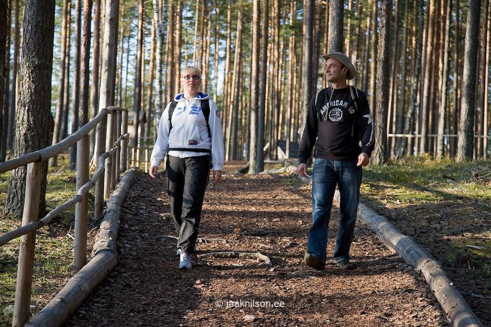 Young Couple on Hiking Trail, Mennikunno Landscape Reserve, Põlva County, Estonia