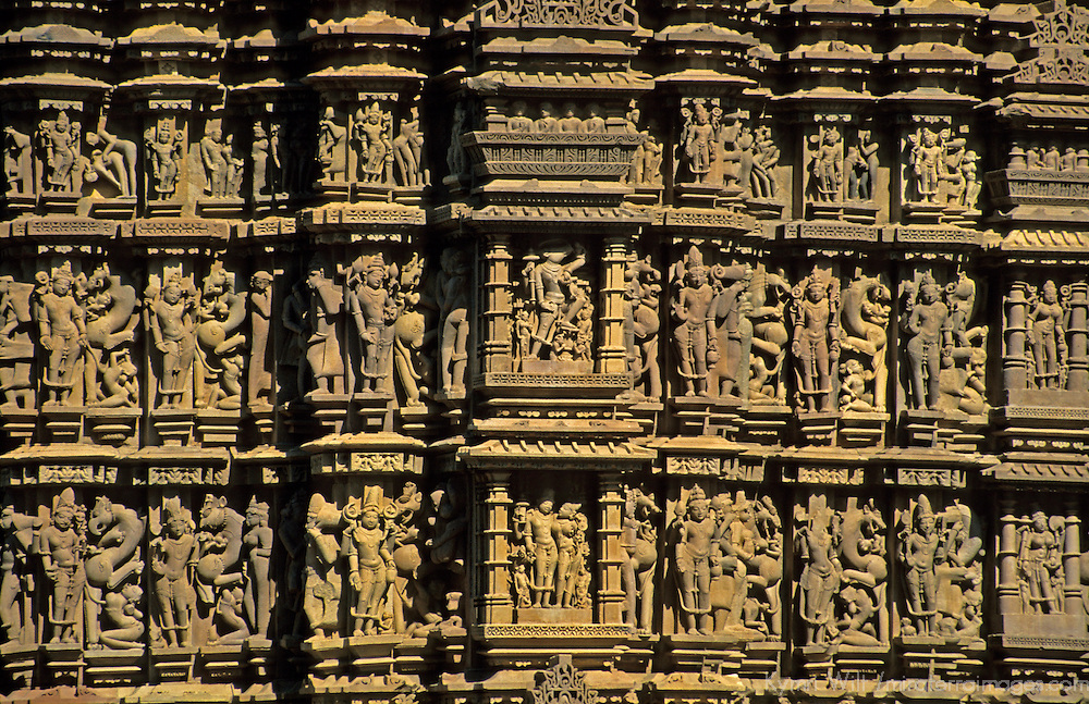 Asia, India, Khajuraho. Erotic carvings remind visitors to leave earthly desires outside the temple at Khajuraho.