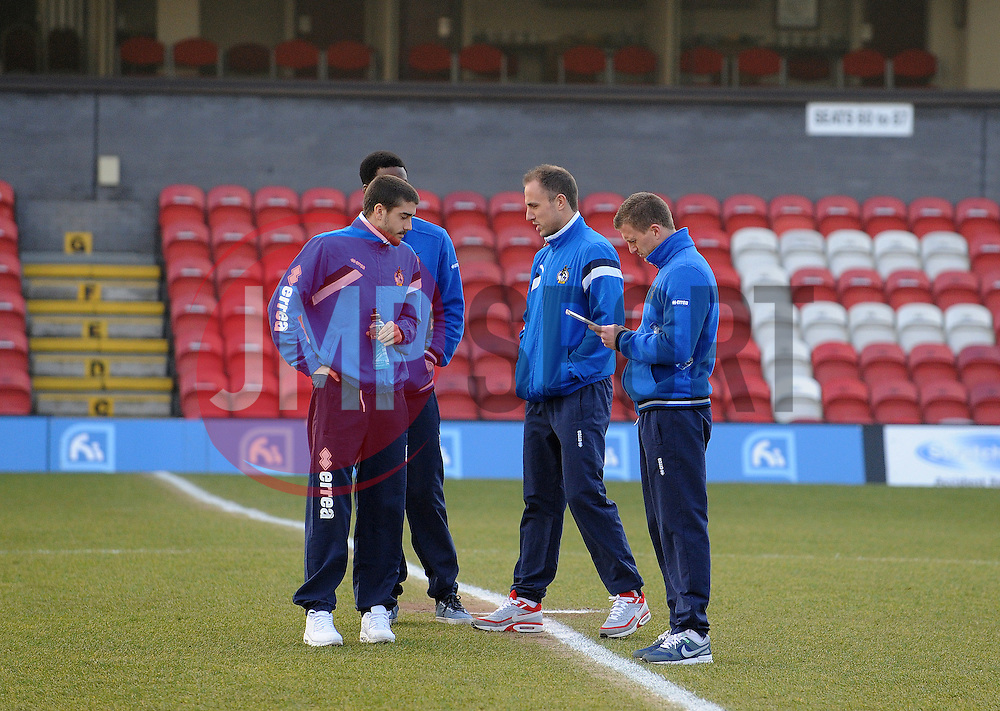 Bristol Rovers players have a look at the pitch - Photo mandatory by-line: Neil Brookman/JMP - Mobile: 07966 386802 - 14/02/2015 - SPORT - Football - Cleethorpes - Blundell Park - Grimsby Town v Bristol Rovers - Vanarama Football Conference