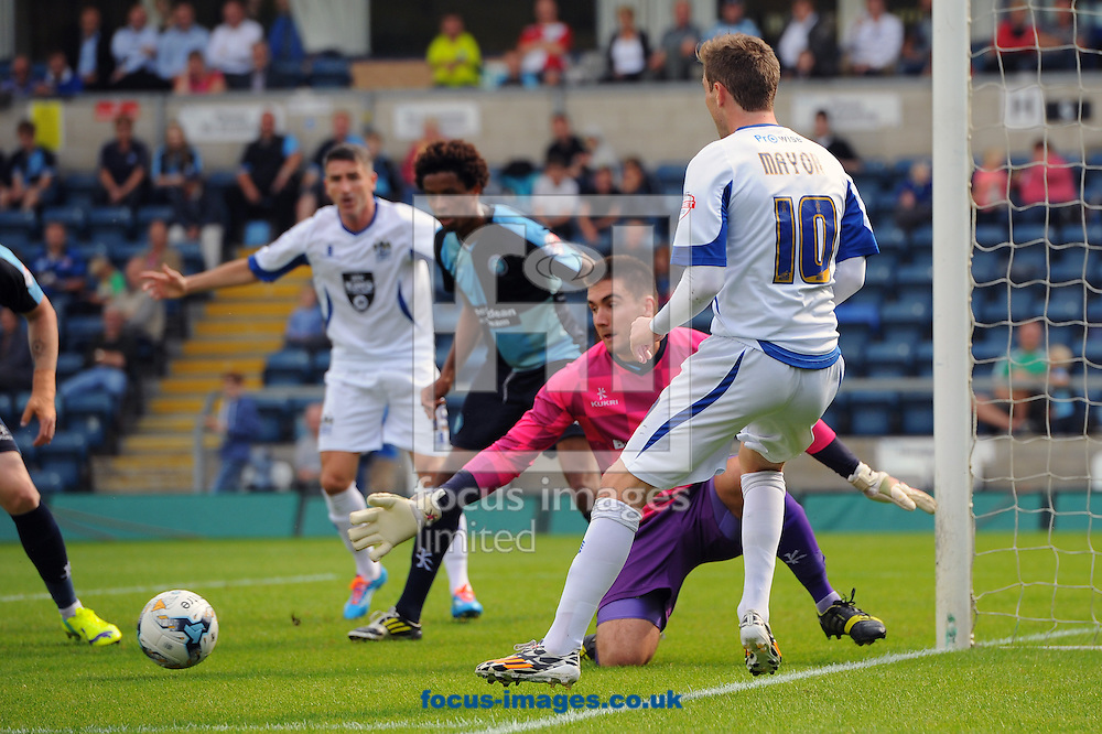 Danny Mayor of Bury looks to square the ball to a teammate during the Sky Bet League 2 match at Adams Park, High Wycombe<br /> Picture by Seb Daly/Focus Images Ltd +447738 614630<br /> 06/09/2014