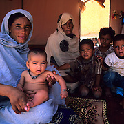 A Saharawi family in the refugee camps of Tindouf, Algeria.