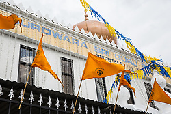 Slough, UK. 28th April 2019. The Gurdwara Sri Guru Singh Sabha on the day of the Vaisakhi Nagar Kirtan procession. Vaisakhi is the holiest day in the Sikh calendar, a harvest festival marking the creation of the community of initiated Sikhs known as the Khalsa.