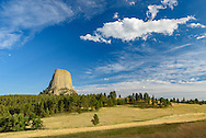Devil's Tower stands tall above the grassland on a July evening.