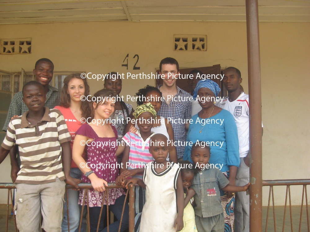 "Ben Kirley Volunteer Work in Sierra Leone.....30.07.12<br /> The woman in blue is my host mother ""Mama Kosia"", surrounded by friends and family.  Her wonderful hospitality made me feel right at home<br /> Picture by Graeme Hart.<br /> Copyright Perthshire Picture Agency<br /> Tel: 01738 623350  Mobile: 07990 594431"