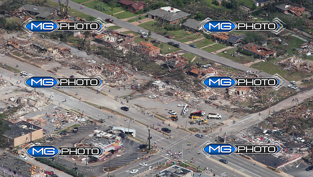 Tuscaloosa, Alabama., April 28 (Reuters) -  An arial view of tornado damage in  Tuscaloosa, Alabama.  The death toll from storms and tornadoes in the U.S. state of Alabama has risen to 128 people, Governor Robert Bentley's office said on Thursday. .    The storms were part of a series that have killed at least 155 people in half a dozen southern states over the last few days. .    They included what may be the most violent twister ever to hit Alabama. It slammed into the college town of Tuscaloosa on Wednesday, killing 15 people, crushing houses, picking up cars and uprooting trees by the hundred.  Mandatory credit: Marvin Gentry.
