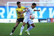 Oxford United defender George Baldock and Swansea City midfielder Jefferson Montero during the The FA Cup third round match between Oxford United and Swansea City at the Kassam Stadium, Oxford, England on 10 January 2016. Photo by Jemma Phillips.