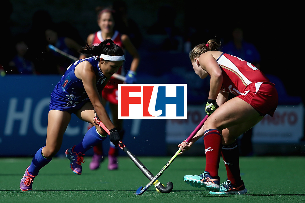 JOHANNESBURG, SOUTH AFRICA - JULY 18: Motomi Kawamura of Japan and Katelyn Ginolfi of the United States battle for possession during the Quarter Final match between the United States and Japan during the FIH Hockey World League - Women's Semi Finals on July 18, 2017 in Johannesburg, South Africa.  (Photo by Jan Kruger/Getty Images for FIH)