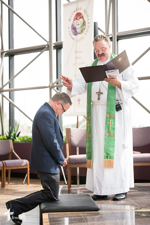 The Rev. Dr. Matthew C. Harrison, president of The Lutheran Church–Missouri Synod, installs Ross Stroh, executive director of LCMS Accounting and Financial Services, in the International Center chapel of The Lutheran Church–Missouri Synod on Wednesday, Sept. 3, 2014, in Kirkwood, Mo. LCMS Communications/Erik M. Lunsford