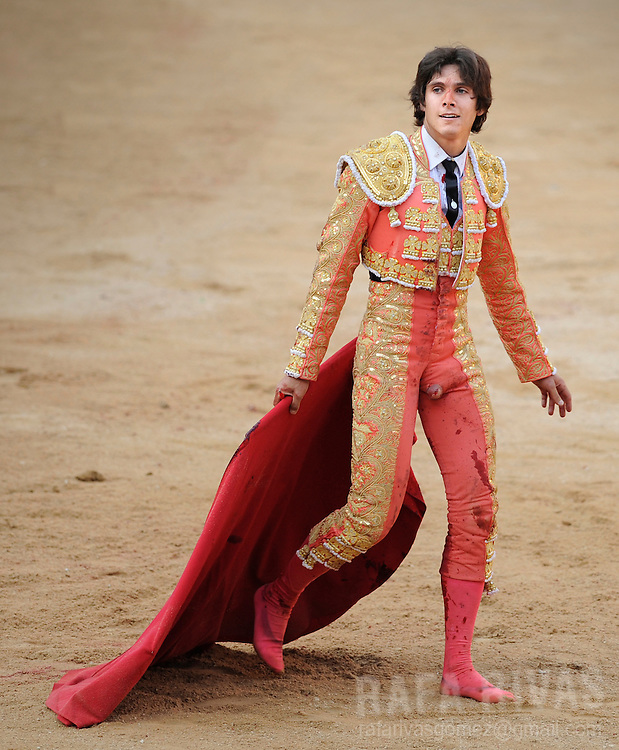 French bullfighter Sebastian Castella walks on the Pamplona bull-ring's sand after being gored by a Fuente Ymbro fighting bull which tore his clothes and left him barefoot, on July 9, 2008, in the Spanish city of Pamplona, during the thirth corrida of the San Fermin festivities.