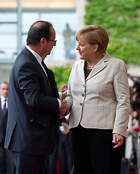 Bildnummer: 57991879..Chancellor Angela Merkel and Franois Grard Georges Nicolas Hollande Visit and Reception with military Honor the French Presidents in Federal Chancellery in Berlin Germany, Tuesday May 15, 2012.Sven Simon/imago/ i-Images