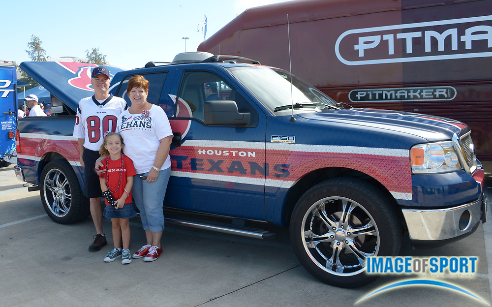 Sep 9, 2012; Houston, TX, USA; Curtis Newton (left), Georgia Newton (center) and Debbie Newton pose in front of their 2006 Houston Texans customized pickup truck before the game against the Miami Dolphins at Reliant Stadium.