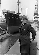 """02/06/1964 <br /> 06/02/1964<br /> 02 June 1964<br /> Mr. C.M. Grace, Engineer Superintendent, Palgrave Murphy Shipping Ltd., at the Liffey Dockyard with the """"City of Cork"""" in background."""