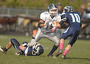 John Glenn's Devin McCulloh (15) gets held up by Petoskey's Quinn Ameel as Tony DeAgostino (10) closes in during the Bobcat's playoff loss to Petoskey.
