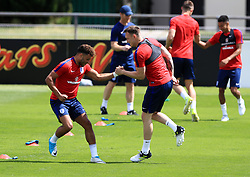 England's Phil Jones (right) and Alex Oxlade-Chamberlain (left) during the training session at Stade Omnisport.