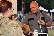 "The West Lampeter Township Police host its annual ""National Night Out"" at the Lampeter Fairgrounds. The evening included demonstrations by local law enforcement, fire and rescue teams and emergency medical technicians. Families enjoyed face painting by Volunteers from Target, Hot Dogs and Fries from Hess's Barbecue and Bull Riding by The Bull Guys. Entertainment was provided by the Lampeter Strasburg Community Band and DJ Chuck Colson. Prizes were awarded to children of all ages."