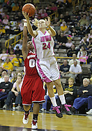 February 16 2011: Iowa Hawkeyes guard Jaime Printy (24) puts up a shot around Wisconsin Badgers guard Jade Davis (00) during the first half of an NCAA women's college basketball game at Carver-Hawkeye Arena in Iowa City, Iowa on February 16, 2011. Iowa defeated Wisconsin 59-44.