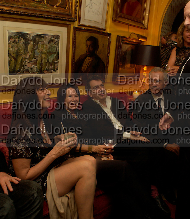 Angelica Huston, ? Bernardo Bertollucci, Michael White. Artists Independent Networks  Pre-BAFTA Party at Annabel's co hosted by Charles Finch and Chanel. Berkeley Sq. London. 11 February 2005. . ONE TIME USE ONLY - DO NOT ARCHIVE  © Copyright Photograph by Dafydd Jones 66 Stockwell Park Rd. London SW9 0DA Tel 020 7733 0108 www.dafjones.com