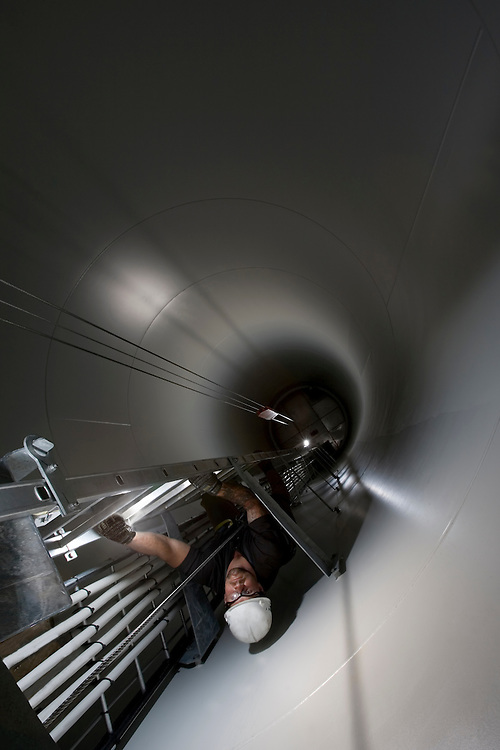 An engineer makes the 220ft climb up to the top of a wind tower. Nine Canyon Wind Project, Richland, Washington.