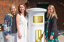 Head of Marketing for the ECB Claire Jackson, left, Jenny Smith, Head of Communications for the ECB and Royal Mail Senior PR Campaigns Manager Jasmine Prichard, right, pose with the white-painted postbox as Royal Mail unveils a postbox outside Lords Cricket Ground with a plaque and graphics that celebrate England's ICC Cricket World Cup Victory. London, July 16 2019.