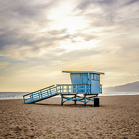 Zuma Beach lifeguard tower #2 in Malibu California during sunset with dramatic sky and clouds