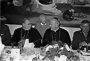 19/07/ 1967<br /> 07/19/1967<br /> 19 July 1967<br /> Cardinal John Cody of Chicago with American pilgrims in Drogheda. Cardinal Cody led 350 pilgrims to the shrine of Blessed Oliver Plunkett in Drogheda. There in the Cathedral he and His Eminence Cardinal William Conway Archbishop of Armagh and Primate of All Ireland consecrated Mass. After mass the Cardinals and pilgrims went to the Medical Missionaries of Mary Hospital for lunch. Picture shows (l-r): His Eminence Cardinal John Cody; Mother Mary Martin, Mother General of the Medical Missionaries of Mary; His Eminence Cardinal William Conway and an unnamed army colonel.