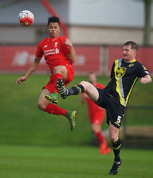 KIRKBY, ENGLAND - Tuesday, January 5, 2016: Liverpool's Allan Rodrigues de Sousa in action against Morecambe's Adam Dugdale during the Under-21 Friendly match at the Kirkby Academy. (Pic by David Rawcliffe/Propaganda)