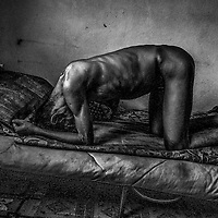 Mohd Sani struggle in pain on his bed.