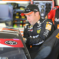 Driver Matt Kenseth enters his car during the first practice session of the 56th Annual NASCAR Coke Zero400 race at Daytona International Speedway on Thursday, July 3, 2014 in Daytona Beach, Florida.  (AP Photo/Alex Menendez)