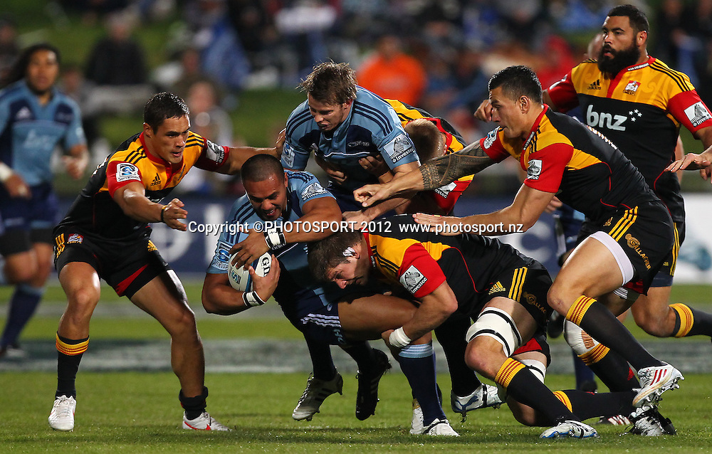 Blues fullback Rudi Wulf is tackled during the Super Rugby game between The Blues and The Chiefs, North Harbour Stadium, Auckland, New Zealand, Saturday June 2nd 2012. Photo: Simon Watts / photosport.co.nz