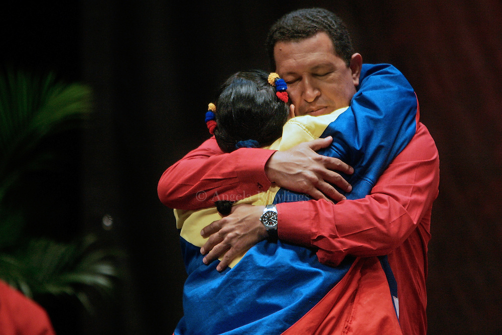 Venezuelan President Hugo Chavez embraces a young woman during an event for university students, Tuesday, November 21, 2006 in Caracas. Chavez will face Manuel Rosales in the December 3 elections.