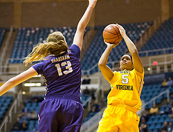 West Virginia Mountaineers forward Averee Fields (5) is blocked by TCU Horned Frogs center Klara Bradshaw (13) at the WVU Coliseum.