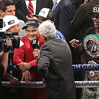 LAS VEGAS, NV - SEPTEMBER 13: Floyd Mayweather Jr. smiles as he points at Marcos Maidana (L) as he is being interviewed after their WBC/WBA welterweight title fight at the MGM Grand Garden Arena on September 13, 2014 in Las Vegas, Nevada. Mayweather Jr. won by unanimous decision. (Photo by Alex Menendez/Getty Images) *** Local Caption *** Floyd Mayweather Jr; Marcos Maidana