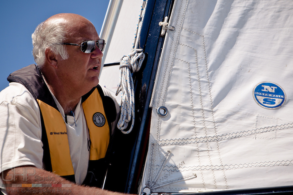 Dan S. assist in changing the sail plan.