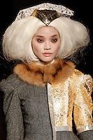 Chen Lin walks the runway wearing Thom Browne Fall 2014 Collection, <br /> Thom Browne (Designer)<br /> Jimmy Paul (Hair Stylist)<br /> Sil Bruinsma (Makeup Artist)<br /> Edward Kim (Casting Director)<br /> Julie Kandalec (Manicurist)