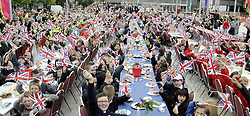 ©  licensed to London News Pictures. .Gravesend UK.28/04/2011.Kent school children parade through Gravesend Town Centre and then enjoy a street party outside Woodville Halls, Gravesend.  600 school children took part in this event today to mark the Royal Wedding of Kate Middleton and Prince William. Please see special instructions..Picture credit should read Grant Falvey/LNP