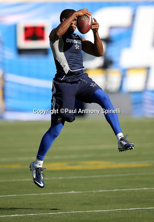 Dallas Cowboys cornerback Byron Jones (31) leaps and catches a pass while warming up before the 2015 NFL preseason football game against the San Diego Chargers on Thursday, Aug. 13, 2015 in San Diego. The Chargers won the game 17-7. (©Paul Anthony Spinelli)
