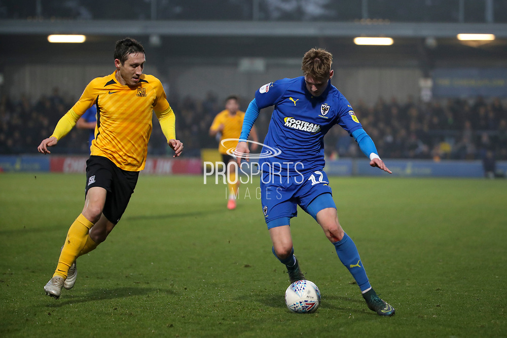 AFC Wimbledon Jack Rudoni (12) battles for possession with Southend United midfielder Mark Milligan (5) during the EFL Sky Bet League 1 match between AFC Wimbledon and Southend United at the Cherry Red Records Stadium, Kingston, England on 1 January 2020.