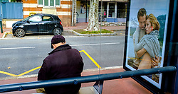 A man waiting for a bus at a bus stop in Toulouse, France<br /> <br /> (c) Andrew Wilson | Edinburgh Elite media
