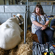 The Royal Highland Show, Scotland's annual farming and countryside showcase, organised by the Royal Highland and Agricultural Society of Scotland.  Two women take a break.<br /> <br /> Wednesday, June 21, 2017