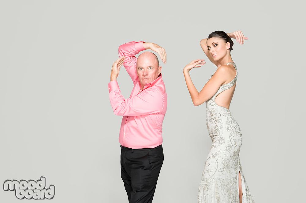 Man and woman striking poses