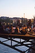 France. Paris. 1st district. large group of people gathering for a piknik with friends on the pont des Arts on the Seine river     / pique nique entre amis sur  la passerelle des arts sur la Seine