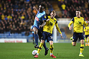 Oxford United midfielder Mark Sykes (18) battles for possession  with Wycombe Wanderers defender Anthony Stewart (5) during the EFL Sky Bet League 1 match between Oxford United and Wycombe Wanderers at the Kassam Stadium, Oxford, England on 21 December 2019.