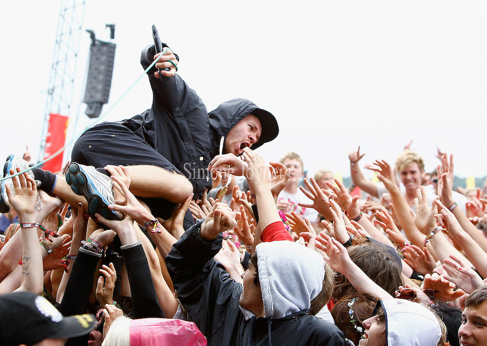 Rou Reynolds of Enter Shikari performs live on the Main Stage during day three of Reading Festival 2011 on August 28, 2011 in Reading, England.  (Photo by Simone Joyner)