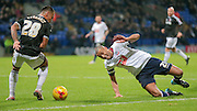 Darren Pratley (C) (Bolton) slips as he tries to go past Nico Yennaris (Brentford) in the box during the Sky Bet Championship match between Bolton Wanderers and Brentford at the Macron Stadium, Bolton, England on 30 November 2015. Photo by Mark P Doherty.
