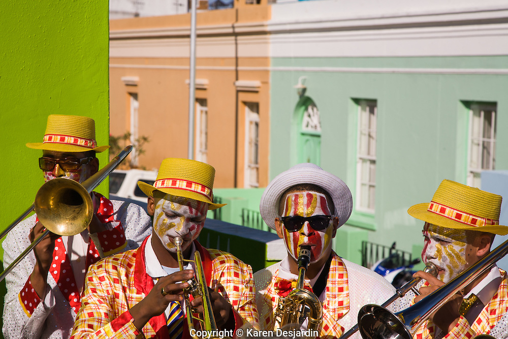 Performers in a traditional minstrel band, play music and march through the Cape Malay quarter of Cape Town, South Africa.