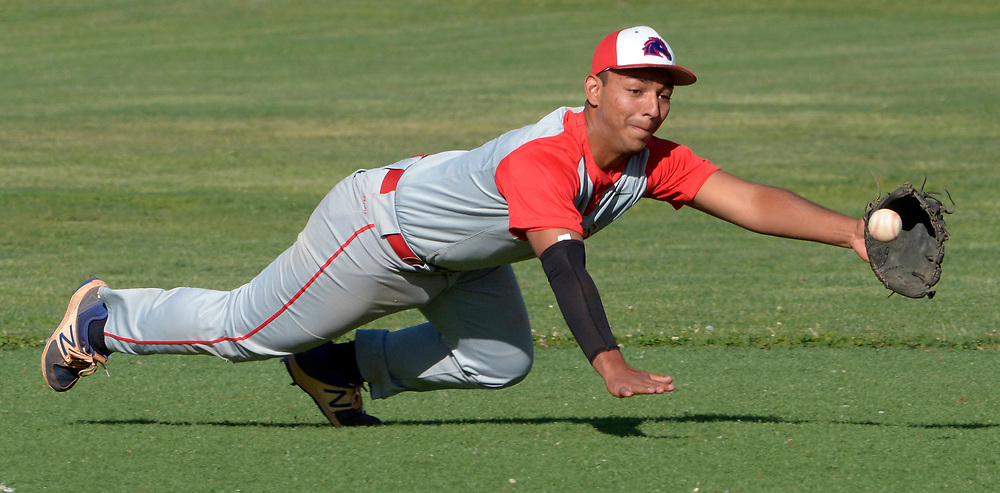 gbs042517r/SPORTS -- West Mesa's third baseman Diego Armijo stretches but misses a line drive during the game at Valley on Tuesday, April 25, 2017.  (Greg Sorber/Albuquerque Journal)